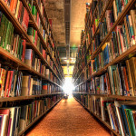 Image of bookshelves on left and right with light shining in the center
