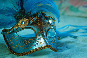 Blue masquerade mask with sequins and feather trim