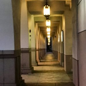 Pasadena corridor with illuminated lanterns.
