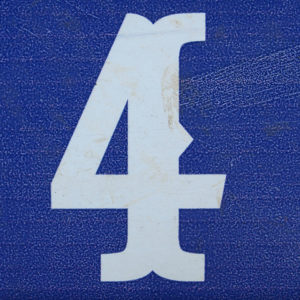 white number 4 on blue background.