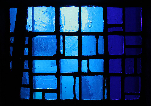 Close-up shot of square blue stained class panels.